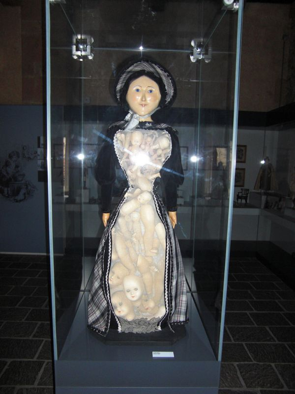 A scary doll in the doll's museum